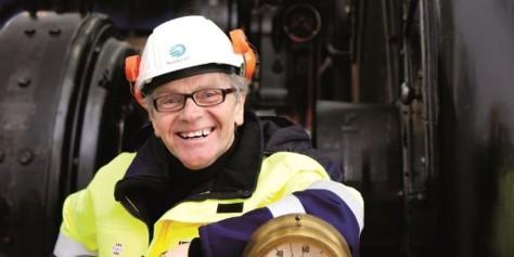 Smiling employee inside power plant