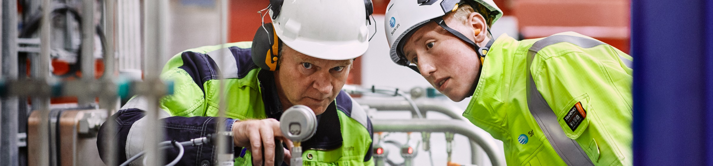 Employees looking at equipment at Ringendalen power plant in Norway