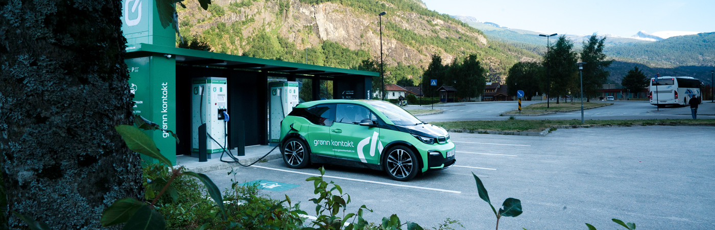 Green car at charging station