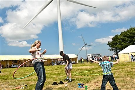 Children plays in wind farm