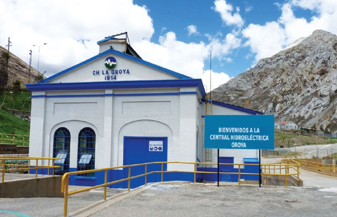 Beautiful white house with blue details at La Oroya