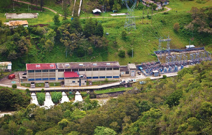 Yaupi Hydropower Plant seen from above with surrounding green fields