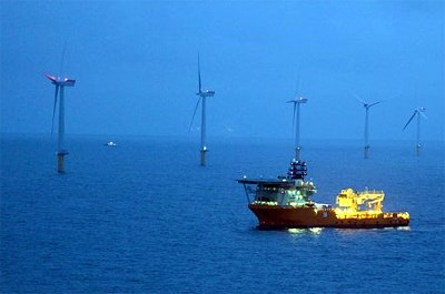 Ship at the Sheringham Shoal offshore wind farm by night