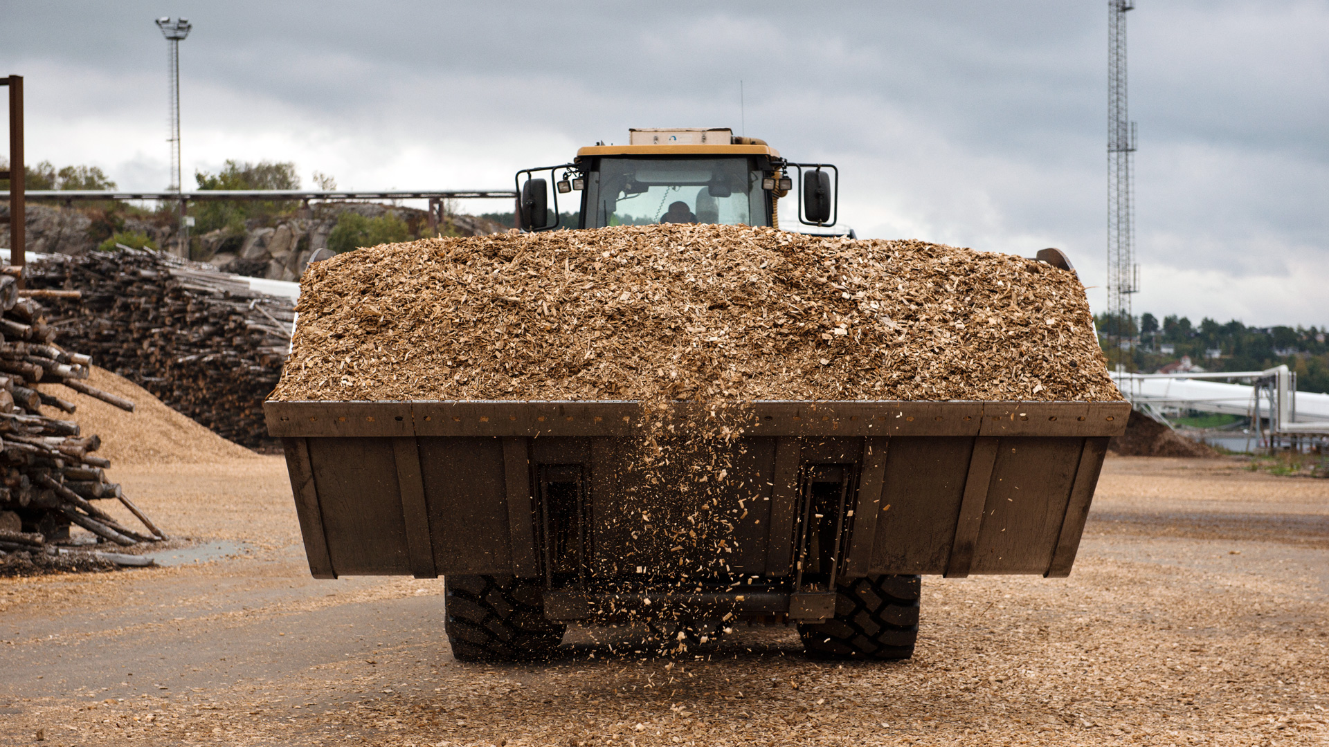 Truck with grab full of wood chips